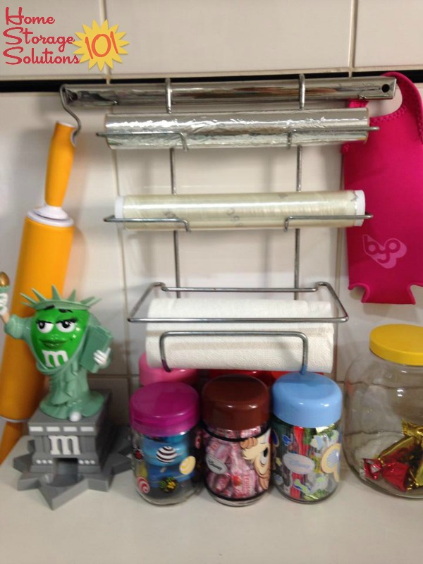 Use a wall mounted holder for your plastic wrap and aluminum foil {featured on Home Storage Solutions 101}