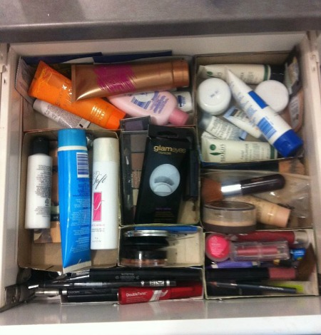 use cardboard boxes as bathroom drawer dividers