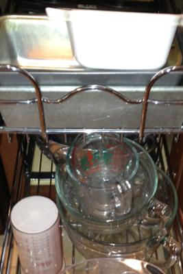 Stores heavy glass measuring bowls and pans