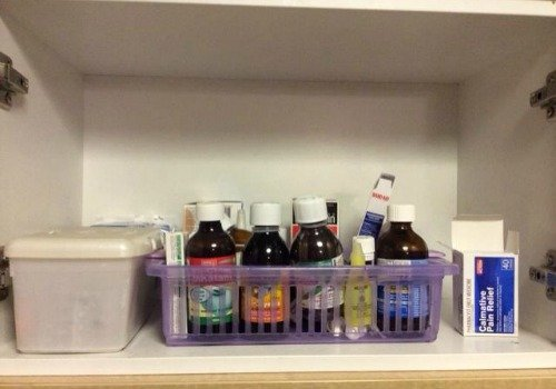 keep medications up high out of reach of children, such as in the cabinet above the refrigerator