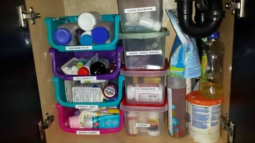 stackable labeled bins for storing medications and first aid supplies