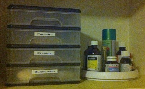 a lazy susan can help you get to medications even in the back of your cabinet without knocking anything over