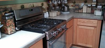Stove and adjacent counters.