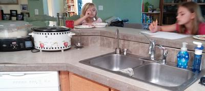 DDs' Using the Breakfast Bar, and sink.