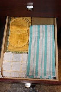 Organized kitchen linens drawer